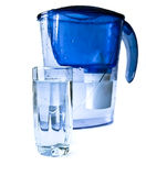 Filirt-pitcher and glass of water. Stock Photos
