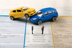 Fill the accident statement after car crash. Concept Royalty Free Stock Images