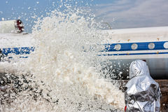 Fill the airplane with fire-fighting foam after emergency landing Stock Image