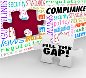 Fill the Compliance Gap Puzzle Wall Hole Follow Rules Laws Regul. Fill the Gap words on a puzzle piece ready to be placed in a hole in a wall with words Stock Photography