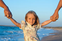 Fill confidence. Small girl on beach holding two hands royalty free stock images