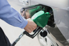 Fill the gas tank. Eco car self service Stock Image