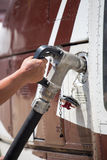 Fill the gas to helicopter. Hand hold fuel nozzle to fill gas to helicopter Royalty Free Stock Photo