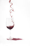 Fill a glass of wine from a rare form. Fill a glass of red wine from a rare form stock photos