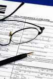 Fill the health insurance claim form Stock Photo