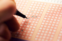 Fill out a bingo lotto lottery ticket Stock Images