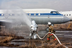 Fill the plane with fire-fighting foam after emergency landing Royalty Free Stock Photography