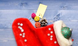 Fill sock with gifts or presents. Celebrate christmas. Small items stocking stuffers or fillers little christmas gifts. Contents of christmas stocking stock image