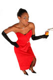 Fill it up. Lady in a red gown holds out her glass for it to be filled up Stock Images