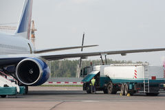 Fill up of an airplane. Men doing fill up of an airplane Royalty Free Stock Photos