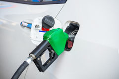Fill up fuel. At gas station Stock Images