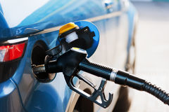 Fill up fuel at gas station. Refill and filling Oil Gas Fuel at station royalty free stock photo