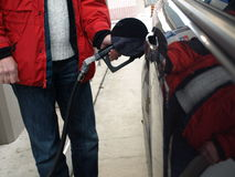 Fill up with gas stock photography