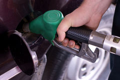 Fill up of gasoline. Hand royalty free stock photography