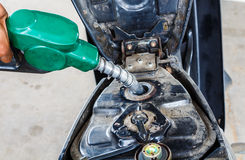 Fill up of gasoline. The man hand fill up of gasoline in gas station Royalty Free Stock Image
