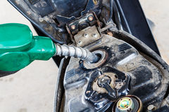 Fill up of gasoline. The man hand fill up of gasoline in gas station Royalty Free Stock Photos