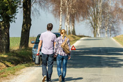 Fill up petrol couple with car trouble Royalty Free Stock Photo