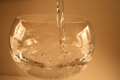 Fill water glass. Water glass filling up and you can see the bubbles stock image