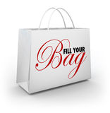 Fill Your Bag Shopping Spree Spend Splurge Binge Money. Fill Your Bag words on a shopping bag to illustrate a spending spree or spluring and binging on Royalty Free Stock Images