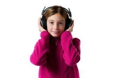 Fille écoutant la musique Photographie stock libre de droits