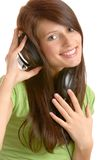 Fille écoutant la musique Images stock