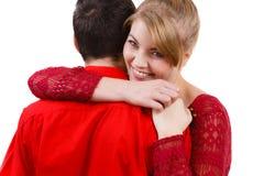 Fille étreignant l'ami de manière romantique Image stock