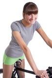 Fille active sur le vélo Photos libres de droits