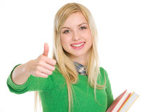 Fille adolescente heureuse d'étudiant affichant des pouces vers le haut Photos libres de droits