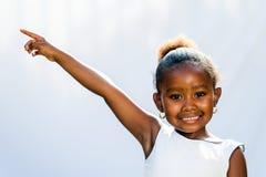 Fille africaine se dirigeant au coin avec le doigt images libres de droits