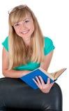 Fille agréable avec le livre dans des mains Image libre de droits