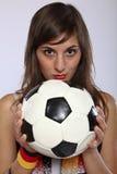 Fille allemande sérieuse de ventilateur de football Photographie stock
