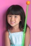 Fille asiatique avec le bâton image libre de droits
