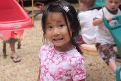Fille asiatique avec le visage effrayé Images stock