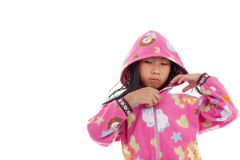 Fille asiatique dans la veste avec le capot sur le blanc Photos stock