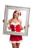 Fille asiatique de Noël avec les vêtements et le cadre de Santa Claus Photographie stock libre de droits