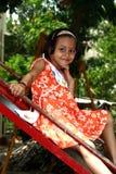 Fille asiatique heureuse sur la glissière Photo libre de droits