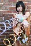 Fille asiatique mignonne avec les jouets furtifs Photographie stock libre de droits