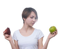 Fille assez jeune avec la pomme verte Photos stock