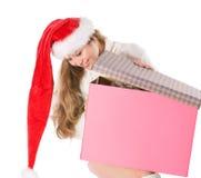 Fille attirante dans le chapeau de Santa avec le cadre de fantaisie Image stock