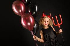 Fille attirante dans le costume de diables de Halloween Photos libres de droits