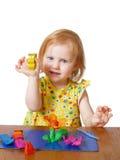 Fille avec de la pâte à modeler Photo stock