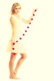 Fille avec de petits coeurs rouges Image stock