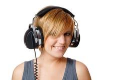 Fille avec des écouteurs Photo stock