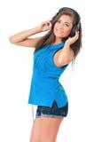 Fille avec des écouteurs Images stock