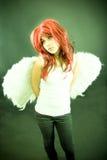 Fille avec des ailes.   Photographie stock