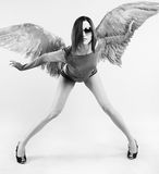 Fille avec des ailes après le dos Photographie stock libre de droits