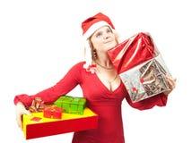 Fille avec des cadeaux de Noël Photographie stock libre de droits