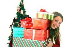 Fille avec des cadeaux de Noël image libre de droits