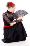 Fille avec des carmen d'une danse de ventilateur Photo stock