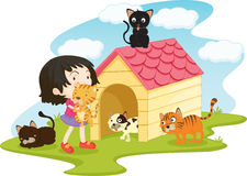 Fille avec des chats d'animal familier Images stock